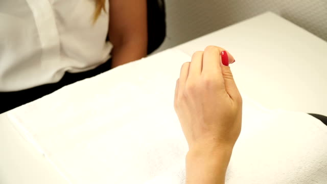 Beautiful woman's hands with perfect manicure at beauty salon Female hand with red nail varnish beautician stock videos & royalty-free footage