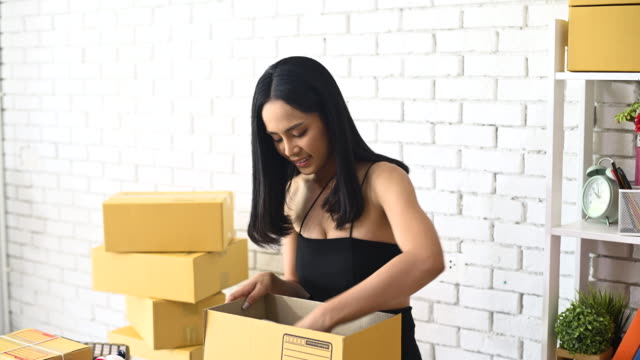 Beautiful women are accepting orders, selling product online concept. - video