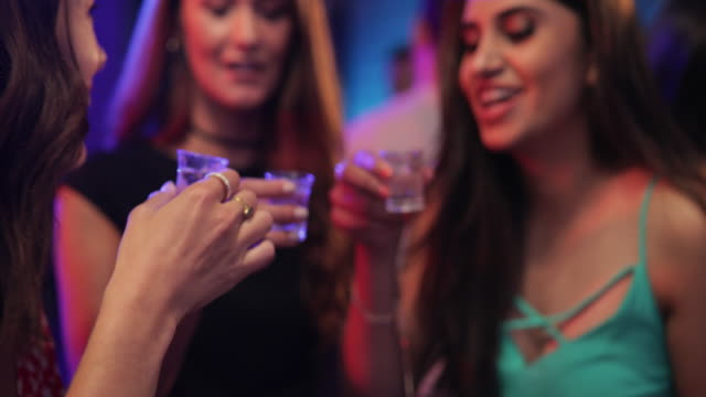 beautiful women drinking shots - vodka video stock e b–roll