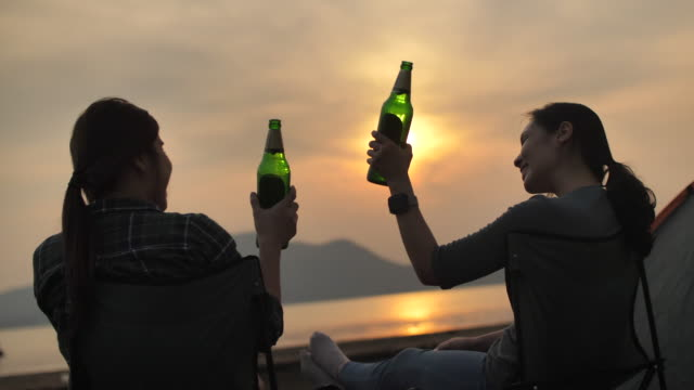 Beautiful women having fun together drinking beer and camping Thailand,Picnic, Camping, Natural Park,Dog,Thailand, Asia, Beer - Alcohol, Dancing, Sea picnic stock videos & royalty-free footage