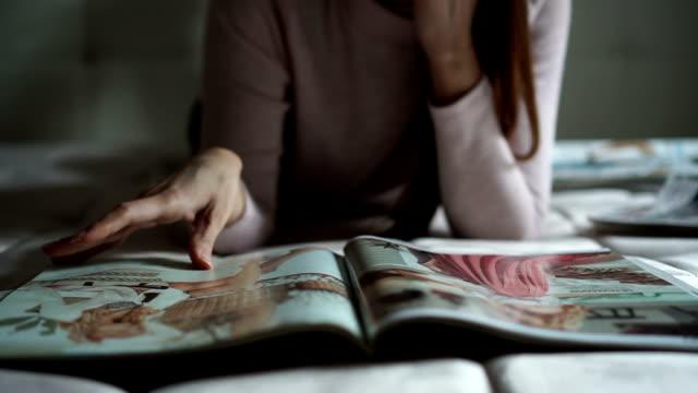 beautiful women reading magazines