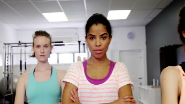 Beautiful women standing in fitness studio - video