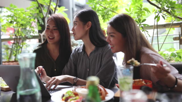Beautiful women using laptop in a restaurant