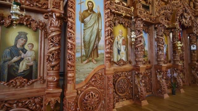 beautiful wooden iconostasis in the new church - ветхий завет стоковые видео и кадры b-roll