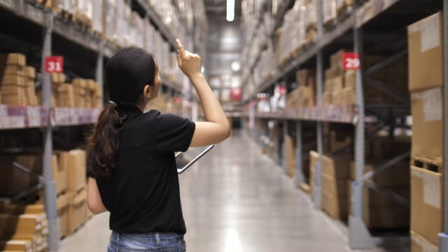 Beautiful worker using tablet in warehouse Beautiful worker using tablet in warehouse stationary stock videos & royalty-free footage