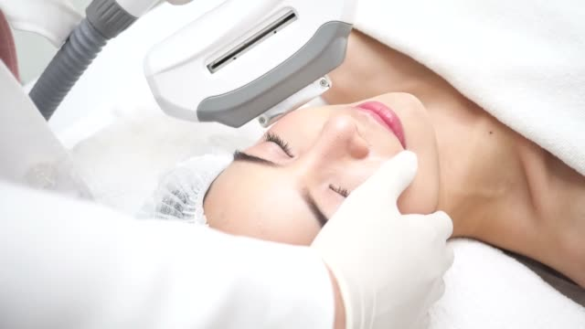 Beautiful young Asian woman getting IPL and laser treatment by beautician at beauty clinic Beautiful young Asian woman getting IPL and laser treatment by beautician at beauty clinic beautician stock videos & royalty-free footage