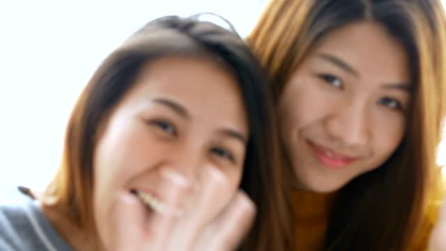 Beautiful young asian woman lesbian happy couple. LGBT lesbian concept. video