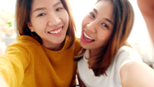 Beautiful young asian woman lesbian happy couple smile to the camera  LGBT lesbian concept. video