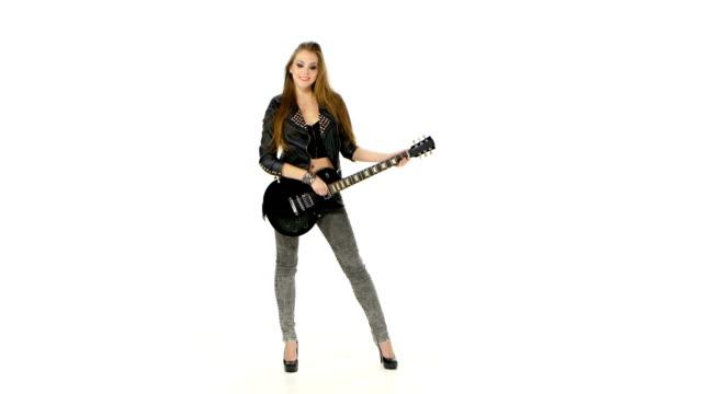 beautiful young brunette girl with the electric guitar on a - gitarrist bildbanksvideor och videomaterial från bakom kulisserna