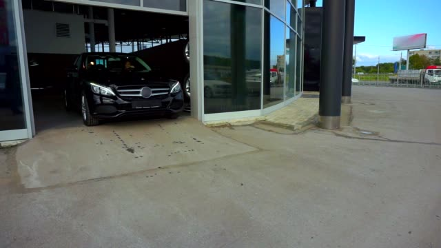 Beautiful young businesswoman buying new car. Leaves the showroom video