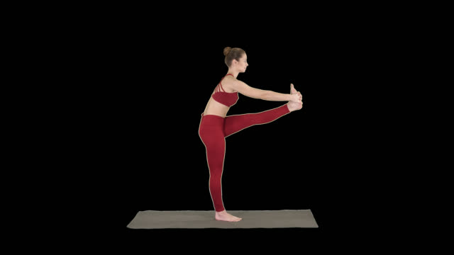 Beautiful young fit woman in sportswear doing sport exercise, bending in variation of Utthita Hasta Padangusthasana, Dandayamana-Janushirasana, Alpha Channel