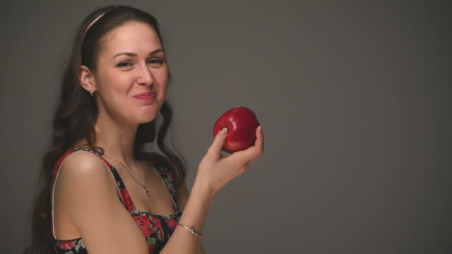 beautiful young girl eats apple - young singles stock videos and b-roll footage