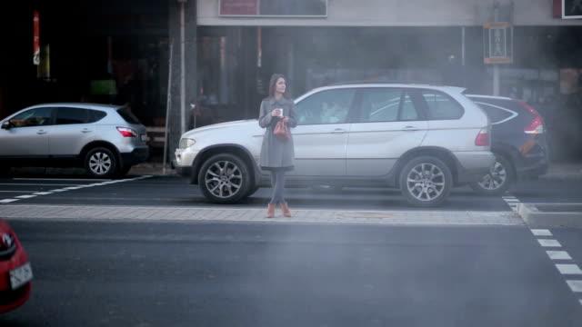beautiful young girl waiting at a crosswalk video
