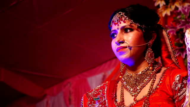 Beautiful young Indian Bride standing on wedding stage