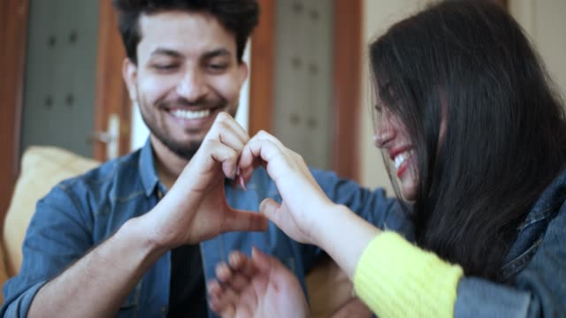 beautiful young indian couple in love - data scritta video stock e b–roll
