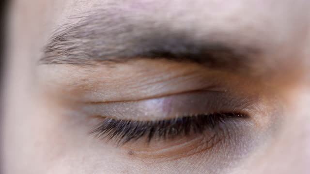 beautiful young man blue eye opening: cute, handsome, attractive, close up young amazing man open his eye in close up footage depression land feature stock videos & royalty-free footage