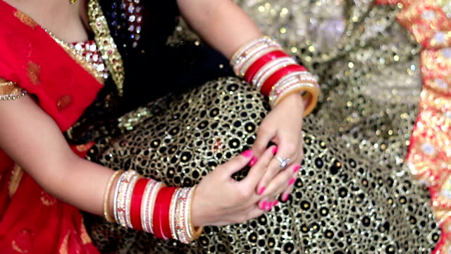 Beautiful young shy Indian bride in traditional wedding dress