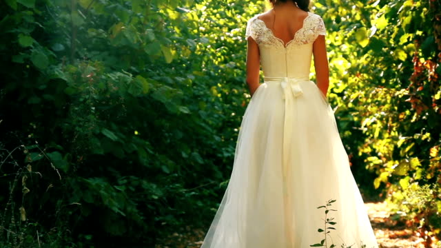 Beautiful Young Woman Bride in Forest Smiling Dress Nature video
