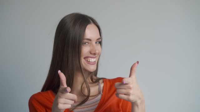 Beautiful young woman complementing on a job well done. video