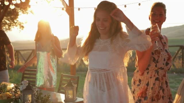 beautiful young woman dancing at sunset - età miste video stock e b–roll