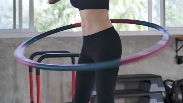 beautiful young woman doing a beautiful figure in the gym - exercise equipment stock videos & royalty-free footage