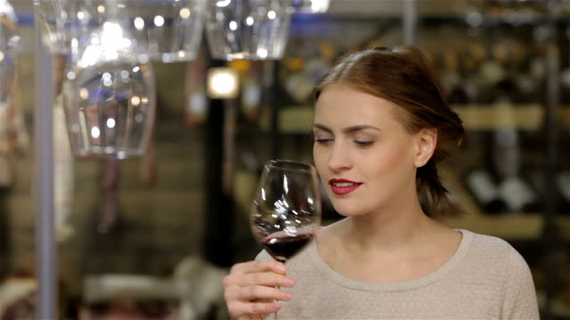 Beautiful young woman drinking wine video