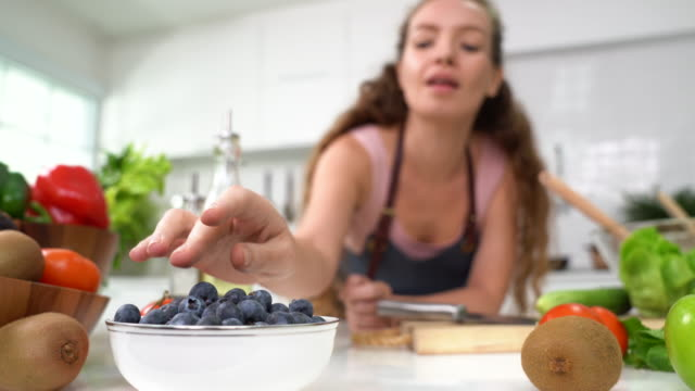 Beautiful young woman eating blueberry Healthy young woman eating bluckberry recipe stock videos & royalty-free footage