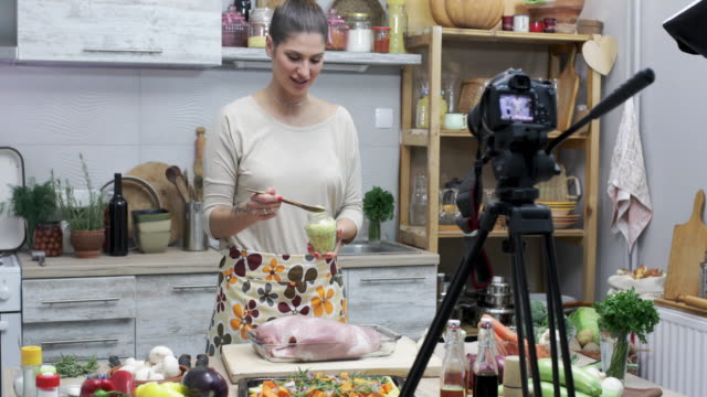 beautiful young woman enjoying at cooking and vlogging - mostrare video stock e b–roll