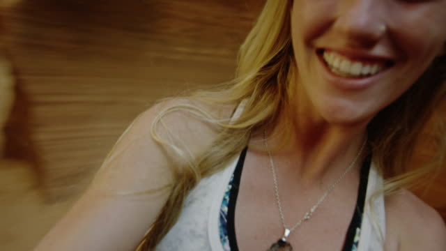 Beautiful young woman films selfie spinning with joy in nature. video