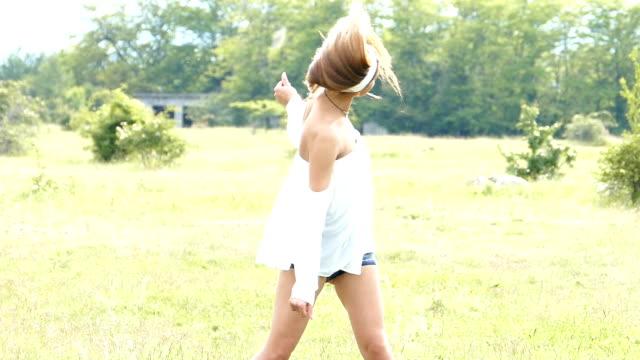 Beautiful young woman having fun in nature,slow motion video