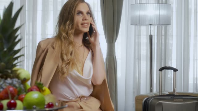 Beautiful Young Woman in a Luxury Hotel Suite video