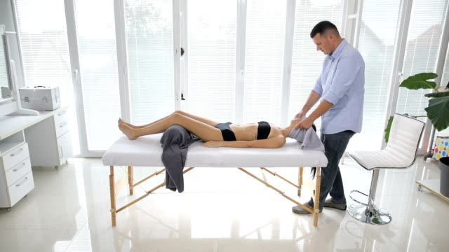 beautiful young woman in spa salon getting massage - chiropractor stock videos and b-roll footage