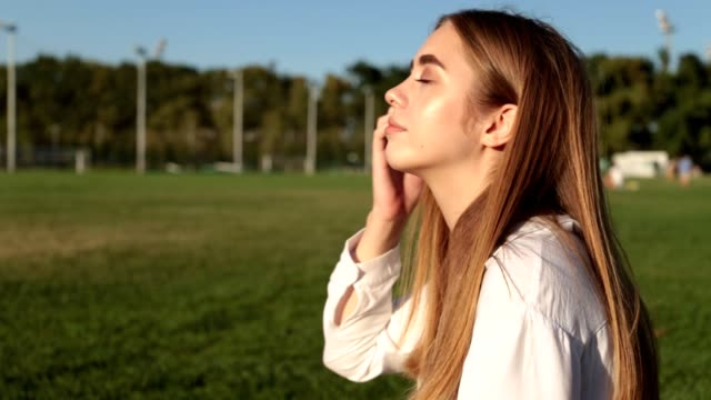 Beautiful young woman in the park. Beautiful young woman in the park. only young women stock videos & royalty-free footage