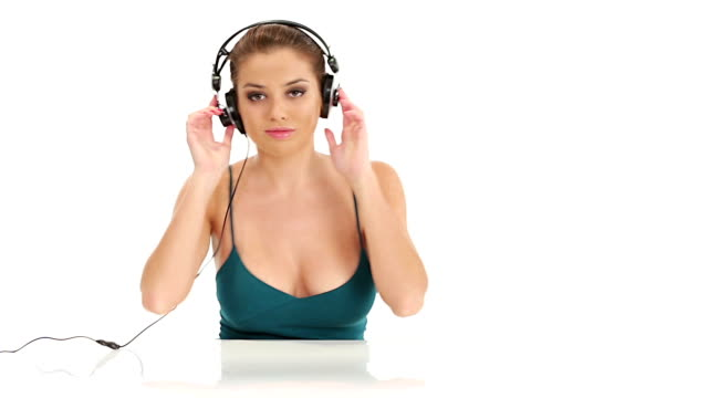 Beautiful young  woman listening music video