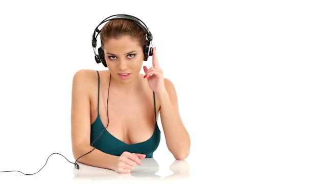Beautiful young  woman listening music video