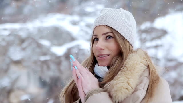 Beautiful young woman on winter travel video