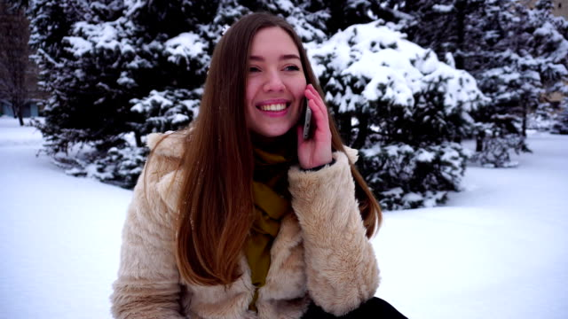 Beautiful young woman talking on phone video