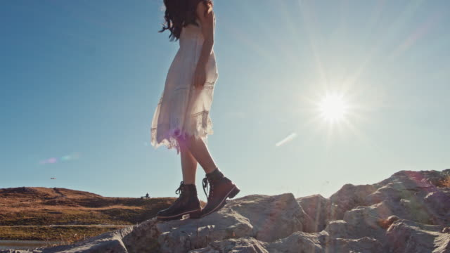 MS Beautiful young woman walking on sunny rocks, enjoying sunny lake view, Loser Mountain, Austria