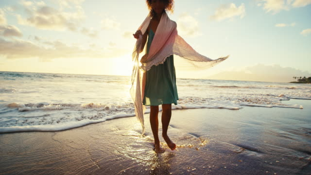 Beautiful young woman walking on the beach in slow motion, soft warm vintage color tone video