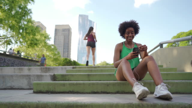 Beautiful young women resting after running video