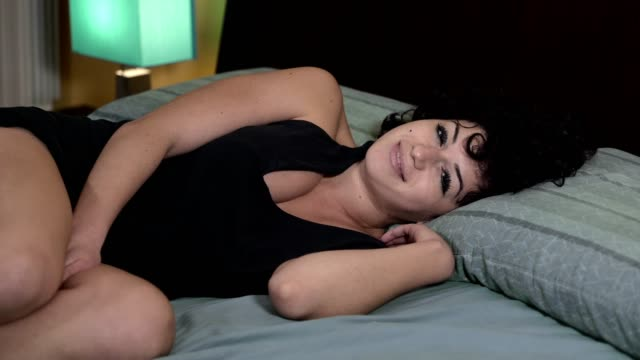 beautiful,charming woman wakes up yawning softly video
