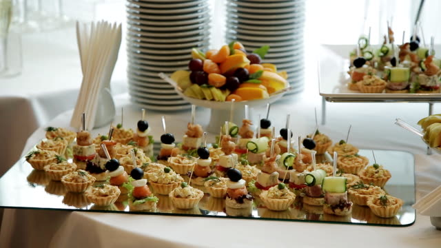 beautifully decorated reception canapes - delis stock videos and b-roll footage