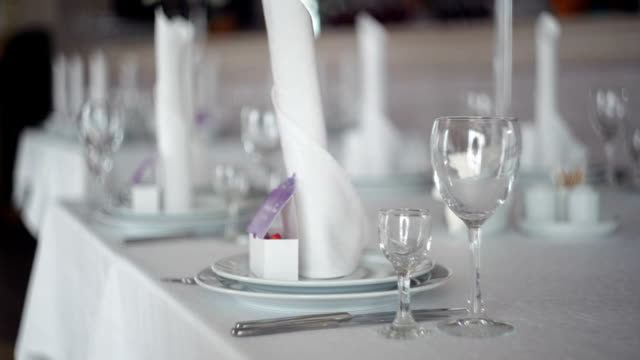 beautifully served table for a wedding dinner in the restaurant video