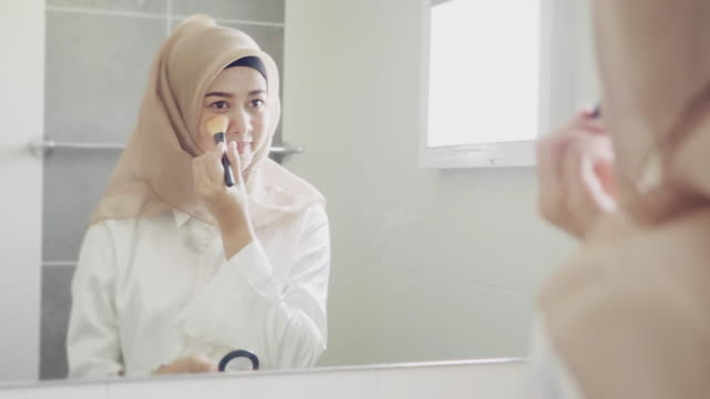 Beautifying herself for the day ahead