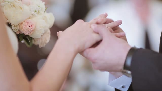 beauty bride and handsome groom are wearing rings each other - matrimonio video stock e b–roll