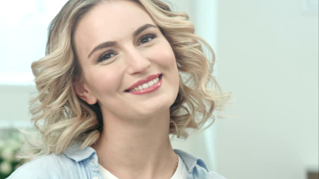 Beauty portrait of beautiful blonde woman smiling at camera video