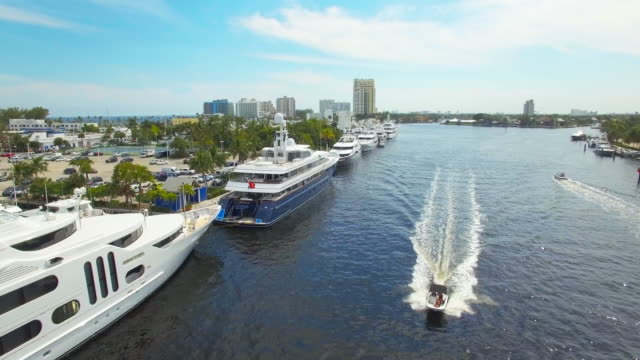 Beauty shots of yachts - 2  ft. lauderdale aerial 4K Fort Lauderdale' s Venice of America and it's magnificent inland waterways. The famous Millionaire's Row which stretches from Tarpon Bend all the way out to the Intracoastal Waterway yacht stock videos & royalty-free footage