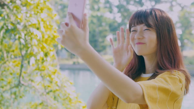 beauty woman selfie happily in the park video