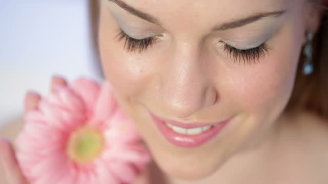 Beautyful Woman with a Gerbera Flower  blue hair stock videos & royalty-free footage
