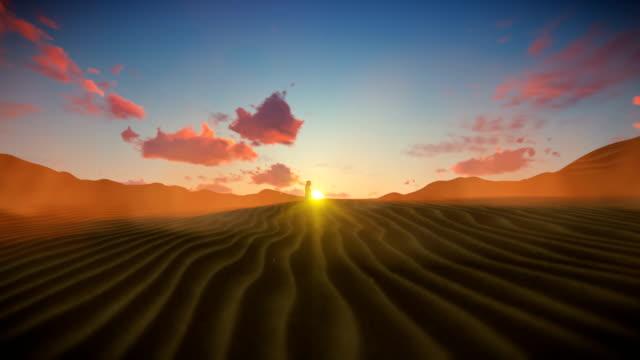 Bedouin crossing dessert against beautiful sunset, 4K